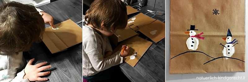 Kind malt mit Fingern Schneemänner auf Geschenktüten