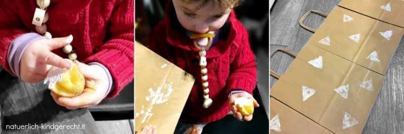 Kleinkind bestempelt mit einem Kartoffelstempel Geschenktüten